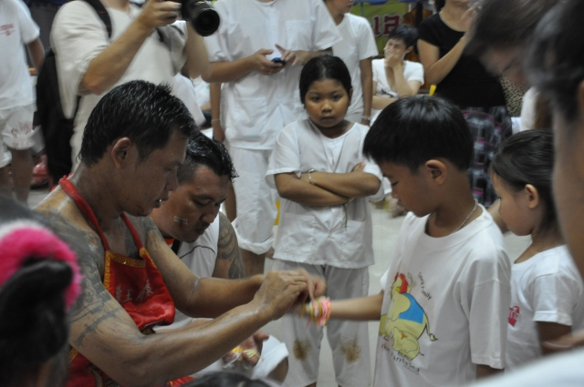 Kids receiving blessing in the Cherngtalay Shrine